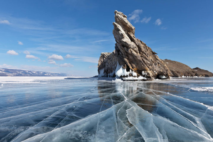 Lake Baikal on a winter day. Beautiful rocks and crack lines on