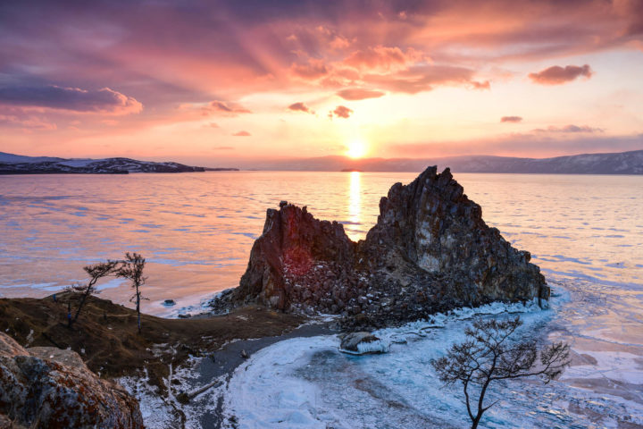 Sunset above frozen surface of the lake Baikal